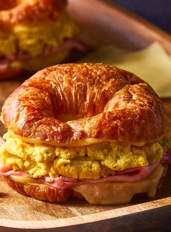 Easy Ham & Cheese Croissants are buttery, cheesy, and extra satisfying! Flaky croissants are overflowing with creamy scrambled eggs, black forest ham, and gooey melted Sliced Chihuahua® Brand Quesadilla Cheese from V&V SUPREMO®.#LoveMyQueso