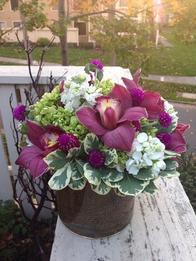 This was my first client in Dublin, CA. He called me to have fuschia cymbidium orchids delivered to his lovely lady. We made a beautiful burlap wrapped flower arrangment with the orchids flowing out of it. They loved it!!