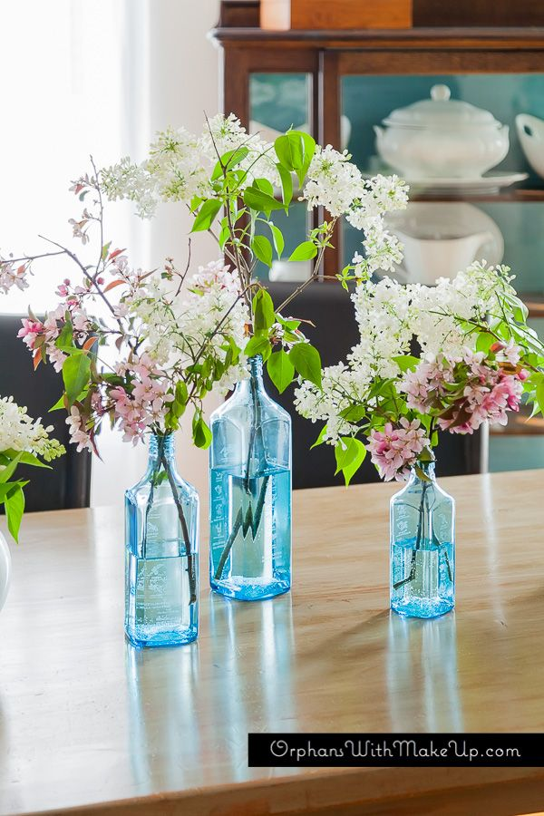 Apple & lilac blossoms. I used recycled Bombay Gin liquor bottles as vases. Love the shade of blue.