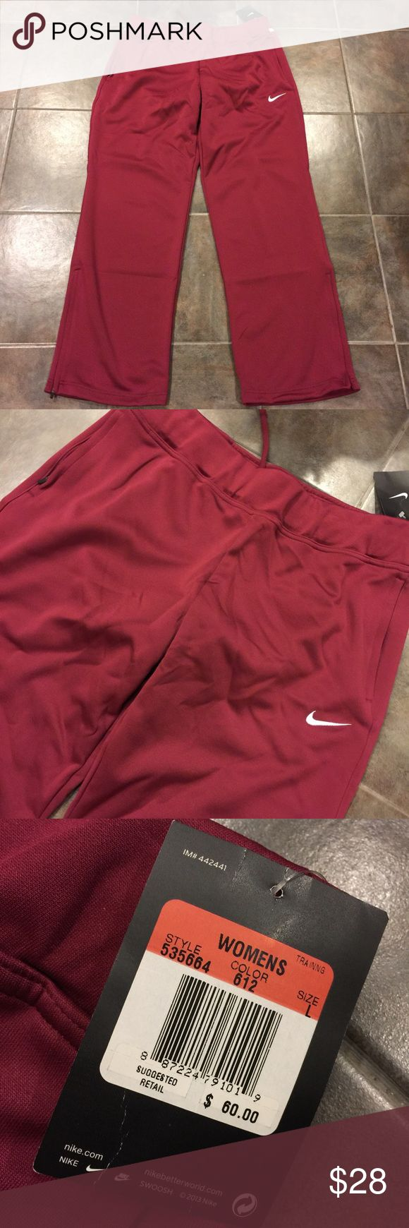 NIKE NWT Deep Red Dri Fit Training Sweatpants Brand new with tags Nike training sweatpants done in Dri Fit material. Gorgeous deep red color with white accents. Size large. Nike Pants Track Pants & Joggers