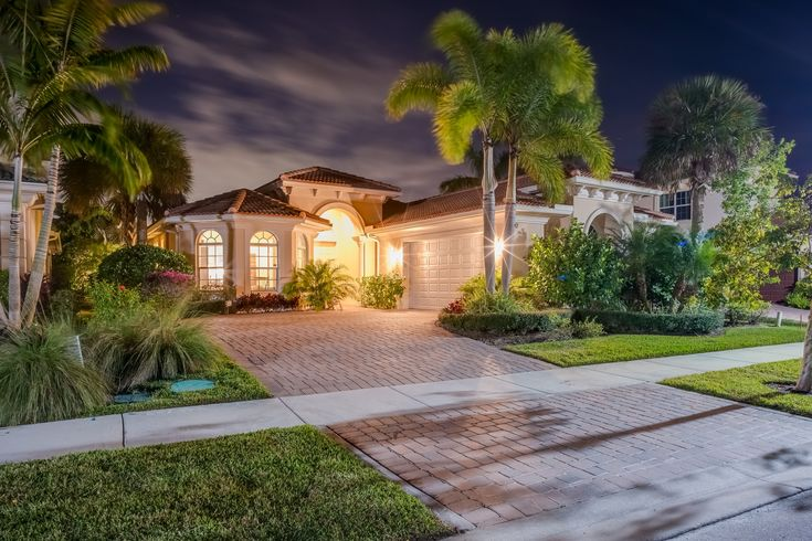 Elegant single-story, 3BR/2½BA + den pool home situated on a private, oversized, fully fenced lot with tranquil preserve views, located in the luxury resort-style community of Jupiter Country Club.