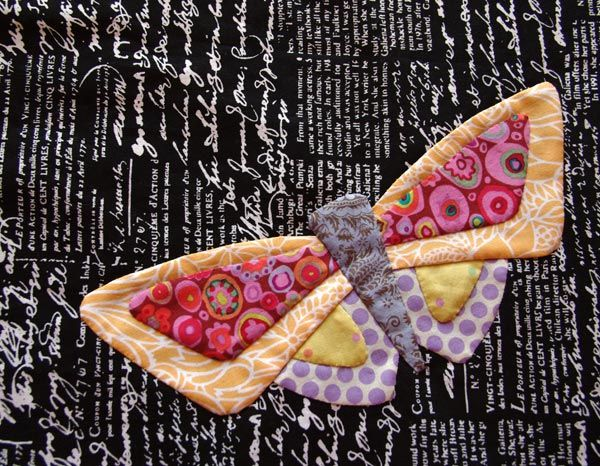 "Bright Butterfly on text fabric from ""All A Flutter"", Matching Pegs."