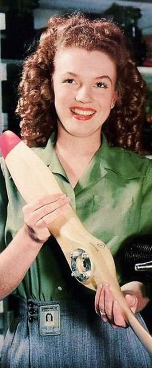 Norma Jeane photographed by David Conover working at the Radioplane Munitions Factory in California, 1944.