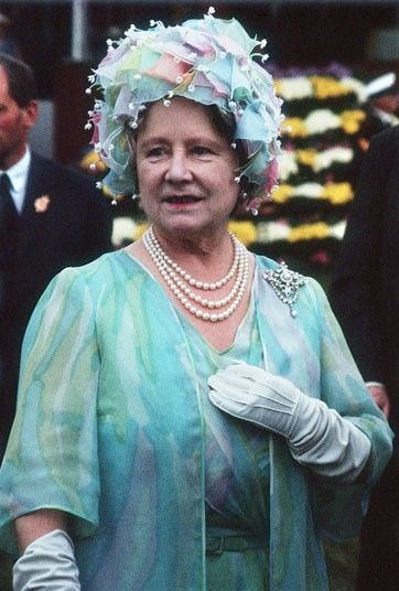 The Queen Mother wears a chiffon pastel outfit  Saw her as a fast moving motorcade passed me in downtown Toronto (late seventies) and I realised who it was in time to wave :)