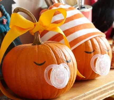Giving a baby shower this month? Here's your centerpiece.Remove the nipple from a pacifier, pin its base to a pumpkin, and add eyes wi...