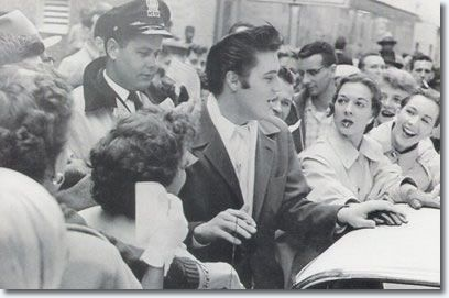Elvis Presley : December 11, 1956 : Mobbed by fans in Memphis after running out of gas