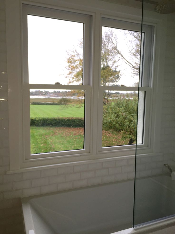 Medina Joinery - Painted white sash windows in a beautiful bathroom in Bosham