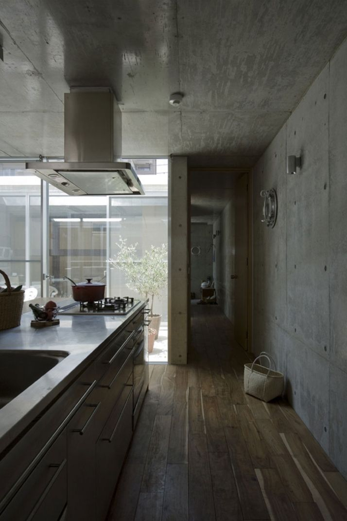 Location: Gojo, Kyoto, Japan  Type of Project: Single family residence/ craft studio  Project Architects: EASTERN design office /// Anna Nakamura and Taiyo Jinno    Interior kitchen space of house with holes. Two other views on this board.