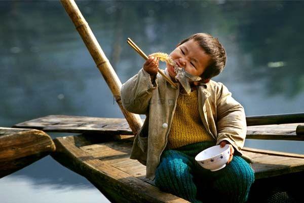 Rui Yuan Boy Eating Fish
