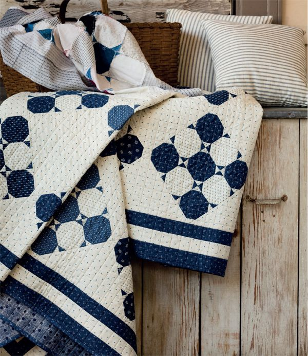 Our heart goes pitter-patter for blue and white. Find this Indigo Snowballs quilt in the book Preserving History.