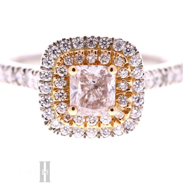 Pink diamond ring in rose gold halo and platinum halo and mount with diamond shoulders.