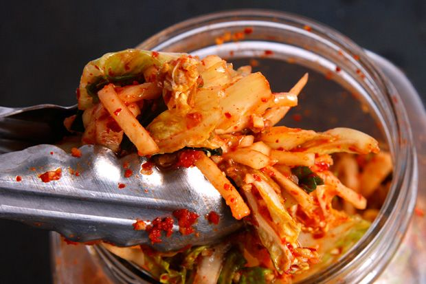 Basic Kimchi.  1 (2-pound) napa cabbage  1/2 C kosher salt  About 12 cups cold water, plus more as needed  8 oz daikon radish, peeled and cut into 2-inch matchsticks  4 medium scallions, ends trimmed, cut into 1-inch pieces   1/3 C Korean crushed red pepper  1/4 C fish sauce  1/4 C peeled and minced fresh ginger (from about a 2-ounce piece)  1 T minced garlic cloves (6-8 medium cloves)  2 t Korean salted shrimp, minced  1 1/2 t granulated sugar