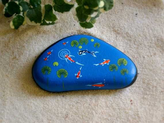 22 best images about painted rocks pond life on for Koi pond gift ideas