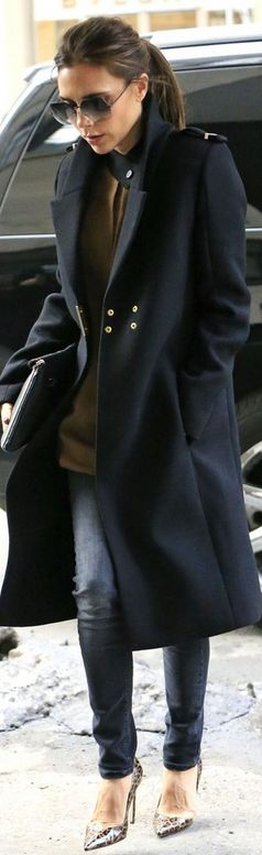 Victoria Beckham, New York. Sunglasses, Jeans, Coat and Shirt: Victoria Beckham Collection. Shoes: Manolo Blahnik