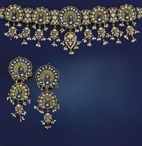 An Indian gold, enamel and cultured pearl choker necklace   Composed of five graduated peacock design strung panels each decorated with colourless sapphires and blue and green Jaipur enamel, each panel reverse with polychrome enamel floral and peacock motifs, suspending matching pear-shaped drops, the central larger drop with colourless sapphire flowerhead motif; and a pair of matching triple graduated panel earpendants