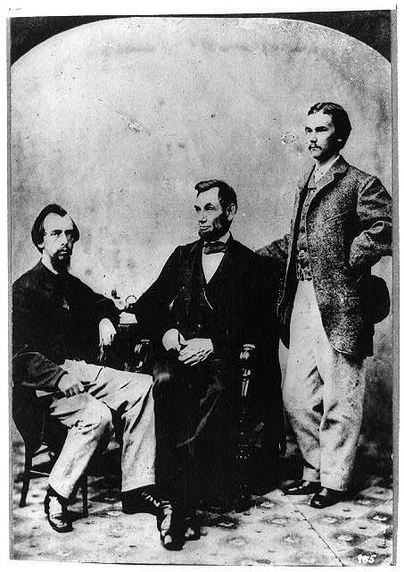 Abraham Lincoln with secretaries John G. Nicolay and John Hay (left), 1863. Photo by Alexander Gardner.