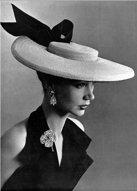 1952 Sophie Malgat in large straw boater adorned with black satin bow by Legroux, brooch and earrings by Roger Scémama, photo by Pottier