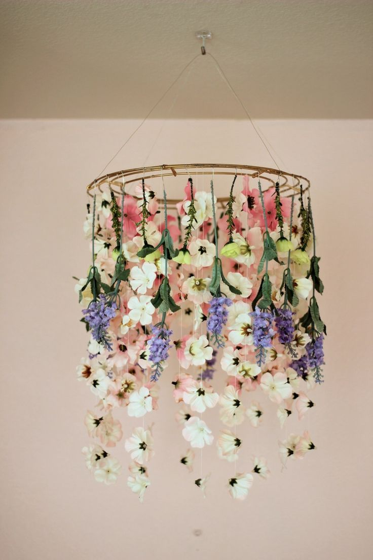 DIY Floral Chandelier: There's nothing wrong with displaying flowers in a vase, but why do that when you can hang them from the ceiling?? Create the ultimate springtime decor with this whimsical DIY floral chandelier using faux flowers, a wreath frame and wire. Bonus: You'll save room on table space for Mom's fave dish