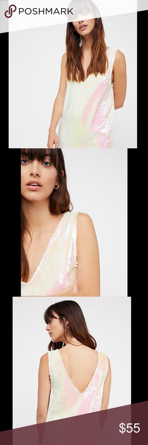 """NWT FREE PEOPLE EMBELLISHED SEQUIN SHIFT SLIP S 100% AUTHENTIC AND IN PRISTINE, BRAND NEW CONDITION WITH TAGS ATTACHED  FREE PEOPLE INTIMATELY EMBELLISHED SLEEVELESS STRETCH SEQUIN SHIFT SLIP PEARL Simple shift slip featuring an ultra glam design with a shimmering sequins allover.  V-neckline Sleeveless Rounded hem 95%Rayon/5%spandex hand wash cold Fit: this style fits true to size. COLOR : PEARL SIZE : S BUST : 19""""APPROX. LENGTH : 31""""APPROX. STYLE : 42120014 ORIGINAL PRICE : $98.00…"""