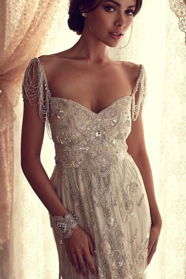 wedding dress - love the beaded details and sleeves