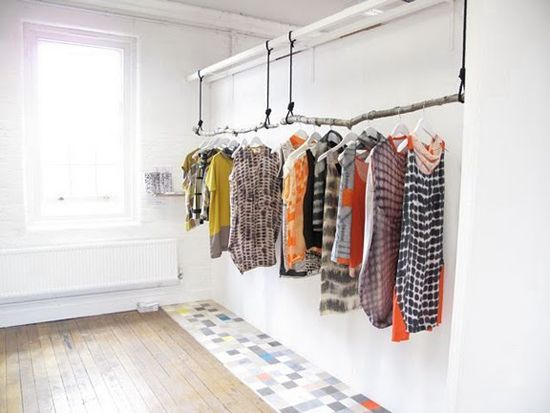 I love natural parts incorporated into decorating. Tree branches as a clothes rod? YES!
