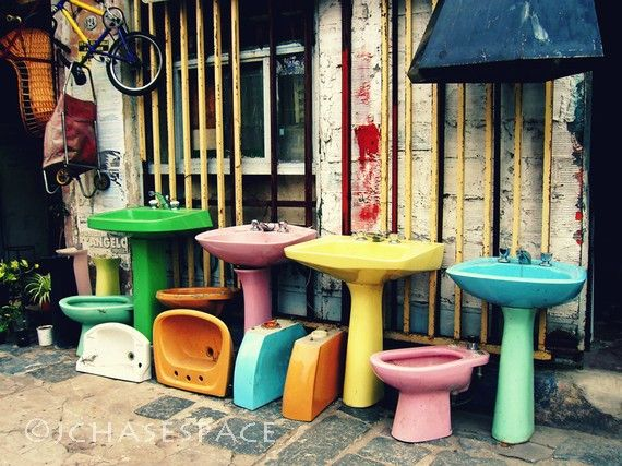 Sourcing colourful suites, now that would be fun. How about differently coloured sink, loo and bath?!