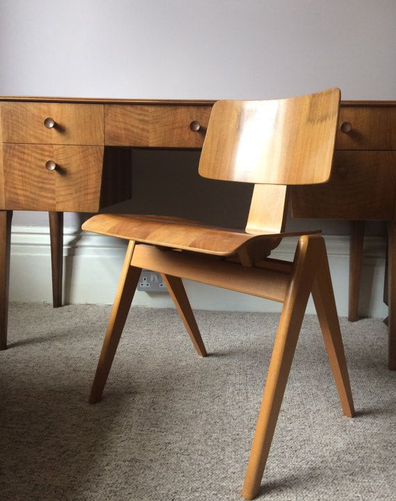 Vintage Robin Day Hillestak chair 1950's by Hille UK. A mid century modern classic incorporating a solid beech frame and gentle walnut faced moulded plywood seat & back, the Hillestak was Days first low-cost production design . The stacking chair was an instant success and has since become an iconic mid century classic. One of the best examples I have come across. The chair was featured in the 2015 V&A exhibition celebrating Robin Days iconic works. Robin Day (1915-2010) is widely reg...