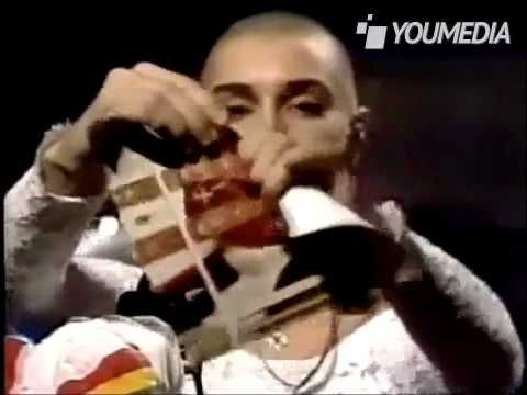 "Perhaps the most notorious—and most watched—banishment from the show belongs to Sinéad O'Connor. In an unrehearsed gesture on the October 3, 1992 broadcast that hadn't been cleared by anyone on the SNL staff, O'Connor ripped a photo of Pope John Paul II in half while singing an a cappella version of Bob Marley's ""War."""