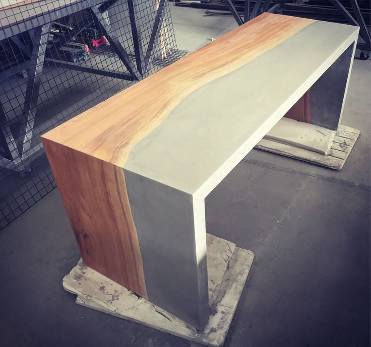 Polished concrete and Matumi wood counter by FLOAT design