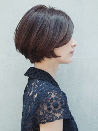 Short haircut for women with straight hair. Modern and elegant hairstyle.
