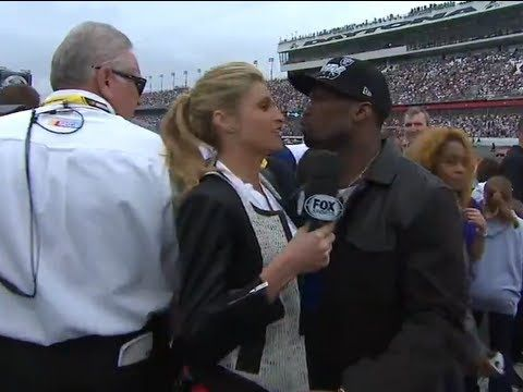 While doing interviews on pit road, Erin Andrews bumps into rapper, 50 cent, who shares an awkward kissing moment. Andrews seems preoccupied as 50 goes in for a smooch.    For more NASCAR news, check out: http://www.NASCAR.com