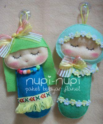 nupi-nupi.. Note the use of tiny bits of trim along the head and bottom edges.