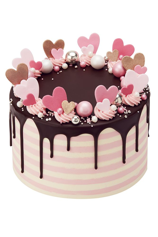 Confetti Hearts Drip CakeDESCRIPTION!This cake will be supplied on either an ivory or silver cake board. Upon request an ivory 'iced' cake board with a personal message can be added. Please contact our Sales Team for details.Portion Guide:6'' : 10 large s