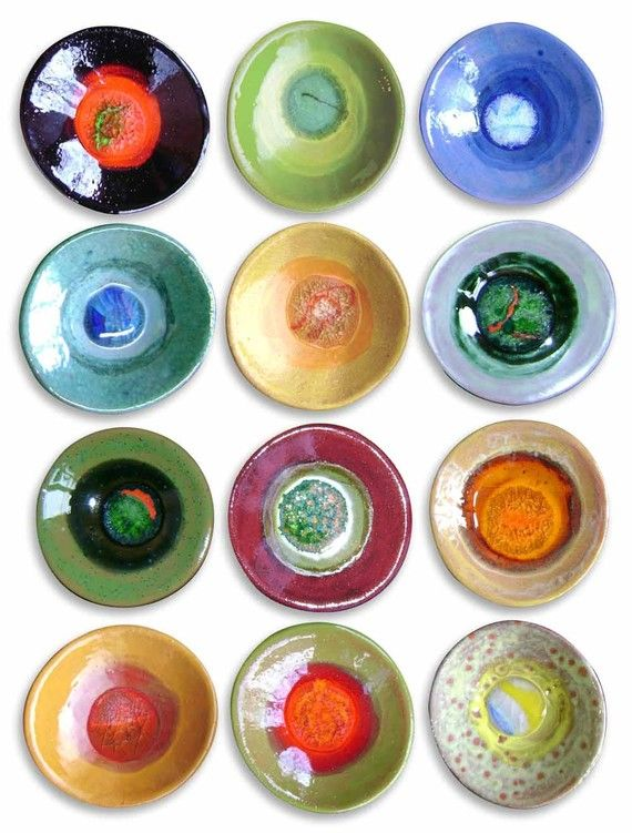 dishes, each fired with a different colored marble in it