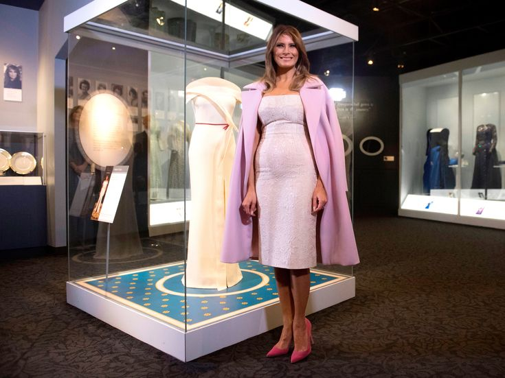 Melania Trump Wears Pink Heels and a White Dress to Donate Her Inaugural Ball Gown  | Melania Trump kept her style simple as she parted ways with her Inaugural ball gown at the National Museum of American History in Washington, D.C., Friday.