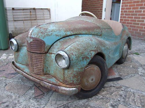 Vintage Pedal Car  ♥ ♥ ♥  (if ever there was a use for Rust-Oleum — this would be it)