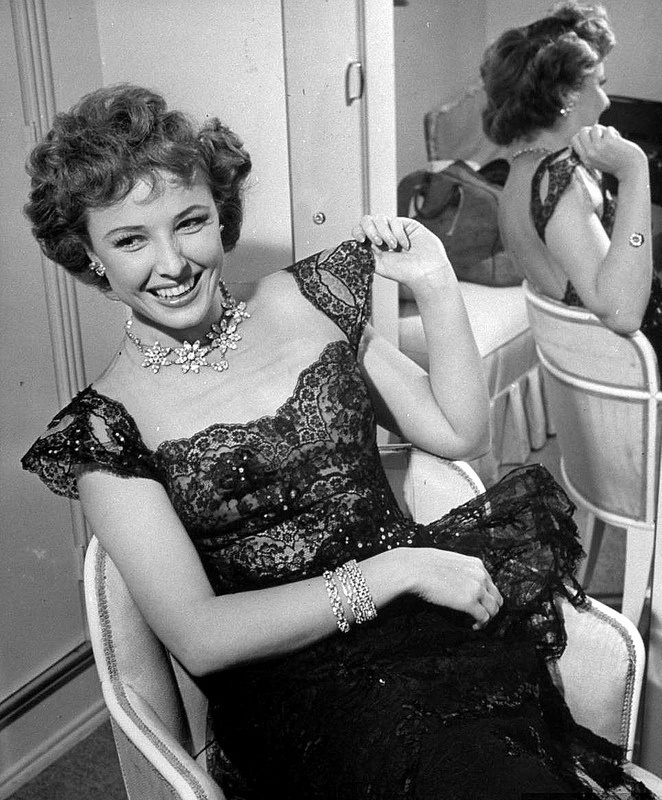 Actress Laraine Day sitting in her dressing room at RKO, photo by Peter Stackpole, Hollywood, 1943