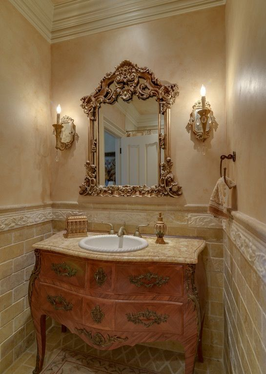 A beautiful powder room with repurposed marble top bombe for Powder room bathroom vanities