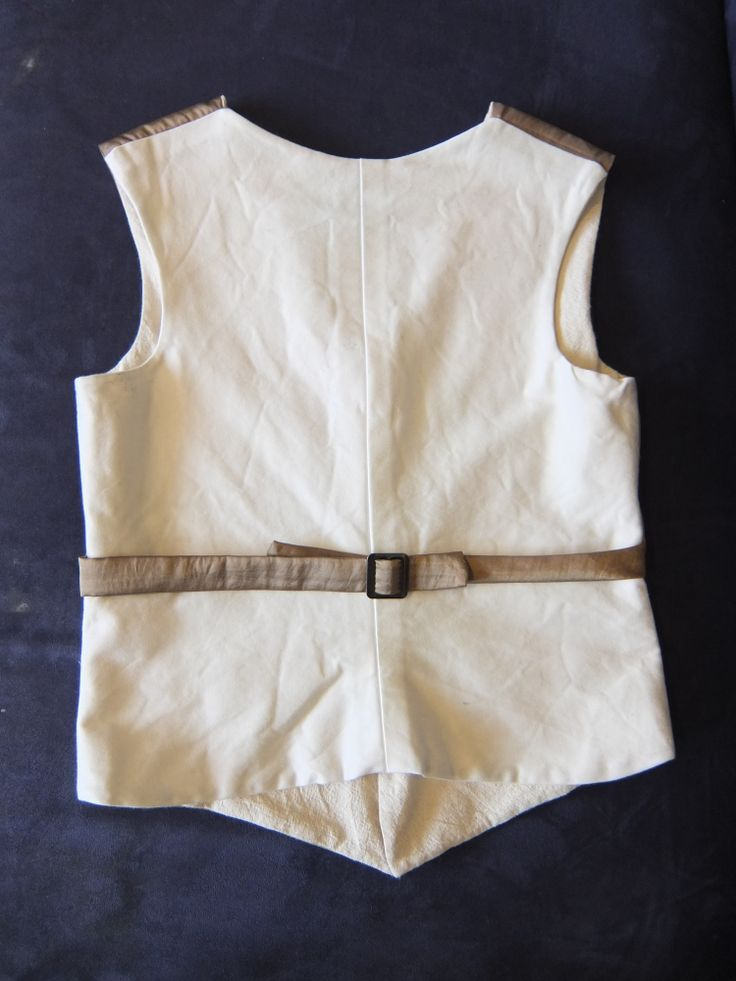 Boy's Eton Vest, circa 1910. This is the white sateen back with antique gold sash with buckle. White is not a good colour for boys, so don't look to closely! 2013