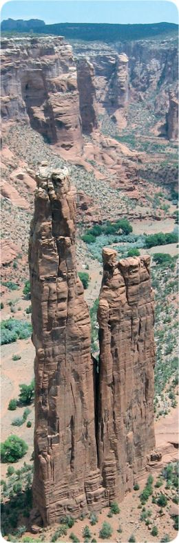 Spider Rock in Canyon de Chelly - located at the confluence of three drainage channels (see Google Earth)   ...surface and subsurface flow from multiple directions during flood conditions carved out this double spire (and the island mesa next to it)