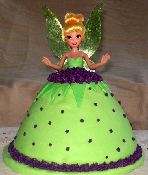 Tinkerbell - This was a strawberry cake, BC and MM fondant. Used Wilton's Wonder Mold for the dress, and found the Tink doll at Walmart.   TLF