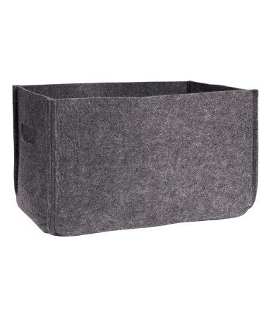 Rectangular storage basket in felt with handles on short sides. Size 7 3/4 x 9 x 12 1/2 in.