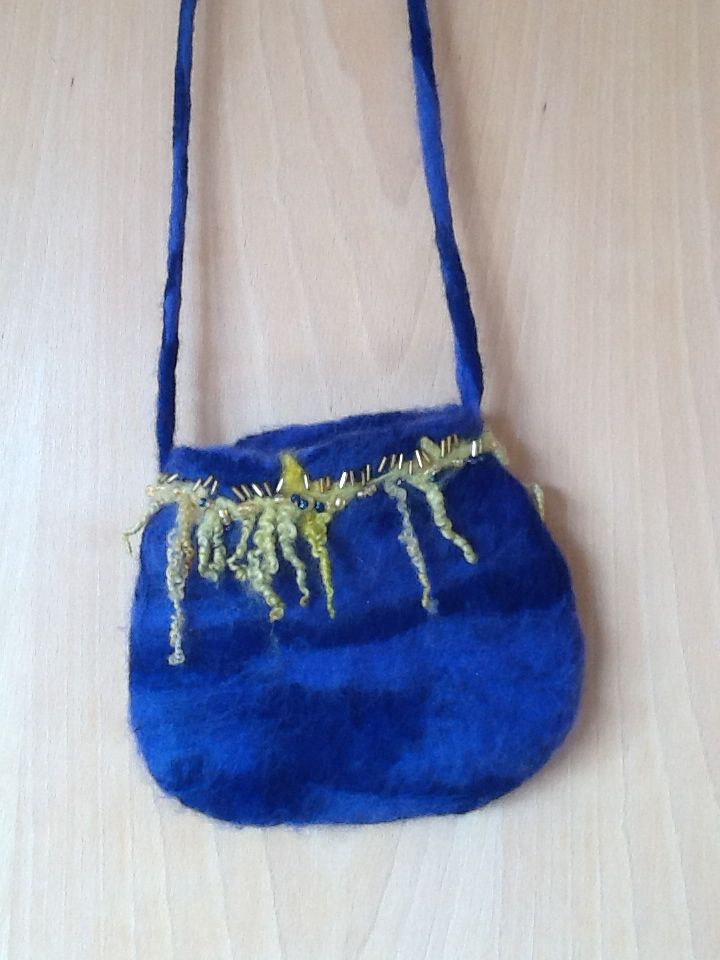 Felt purse decorated with beads and wool