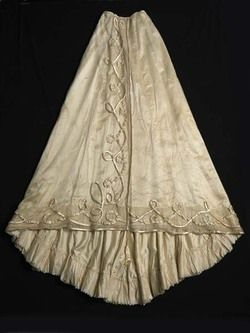Skirt  Janet Arnold included this dress in her book 'Patterns of Fashion: Englishwomen's dresses and their construction c. 1860-1940' (pages 50-51). She described it as 'a reception gown in white spotted net over a foundation of ivory satin and ruched satin ribbon.' - See more at: http://collections.museumoflondon.org.uk/Online/object.aspx?objectID=object-81519&start=8&rows=1#sthash.DqgMgASM.dpuf