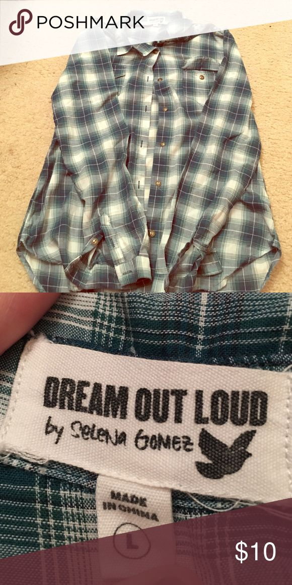 Selena Gomez Dream Out Loud Shirt Blue and white checkered button up plaid shirt by Selena Gomez's Dream Out Loud Campaign. Size Large. All buttons are present, there's no rip, tears or holes. Only worn a few times and does not fit anymore. The sleeves have little buttons for design on the shoulders, and they bottom at the wrists. Dream Out Loud Tops Button Down Shirts