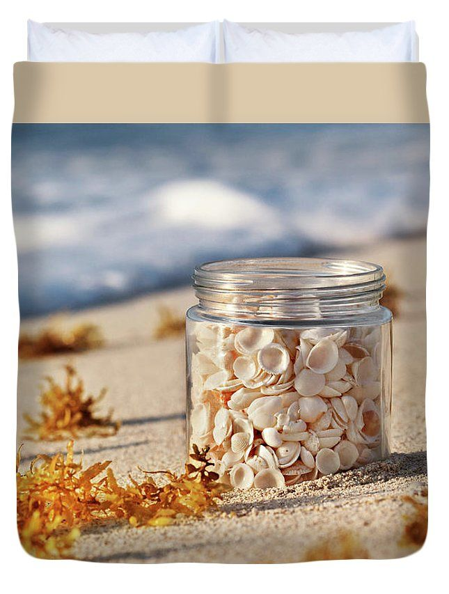 Duvet Cover featuring the photograph The Story by Evgeniya Lystsova. Shells in a glass jar on the sandy beach at sunrise in Cancun, tropical landscape. Make your Bedroom special with stylish art you choose! Our soft microfiber duvet covers are hand sewn and include a hidden zipper for easy washing and assembly. Your selected image is printed on the top surface with a soft white surface underneath. All duvet covers a machine washable. SHIPS WITHIN 3-4 business days!