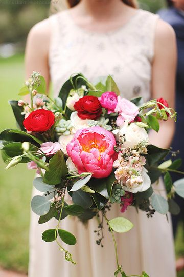 loose unstructured bridesmaid bouquet of coral charm peony red ranunculus vendala roses hot