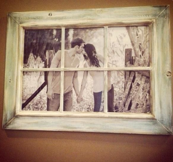 With home decor the possibilities are endless these days! I love this technique of repurposing an old, distressed window frame to display photos of life's special milestones. It's like peering out of a window and taking a trip down memory lane. Anything from wedding, engagement, family portraits and even candid moments, especially if photographed in a natural outdoor setting, will look amazing! Photo Source: couchesandcupcakes.blogspot.ca