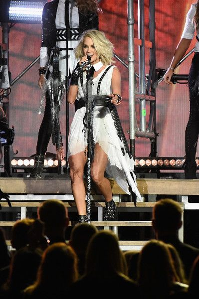 Carrie Underwood Photos Photos - Carrie Underwood performs onstage at the 50th annual CMA Awards at the Bridgestone Arena on November 2, 2016 in Nashville, Tennessee. - The 50th Annual CMA Awards - Show