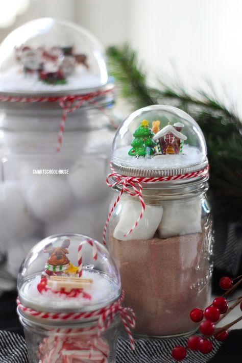 How to make a Mason Jar Lid Snow Globe for Christmas using a clear plastic ornament. ADORABLE! Easy for everybody to do! DIY Christmas gift in a jar idea.
